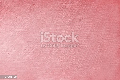 911885384 istock photo aluminium texture background with rose gold color, pattern of scratches on stainless steel. 1127263105