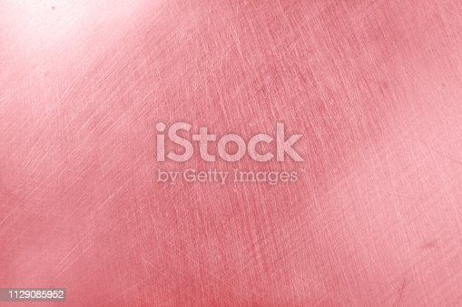 istock aluminium texture background with rose gold color, pattern of scratches on stainless steel. 1129085952