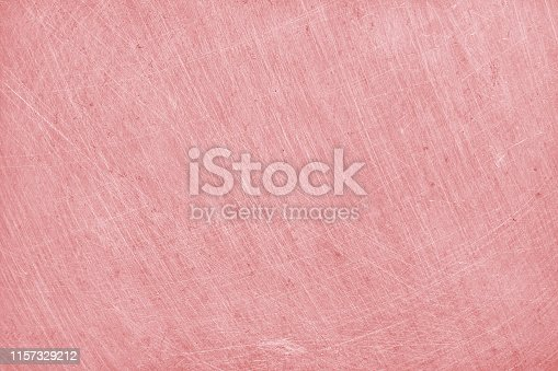 istock aluminium texture background with rose gold color, pattern of scratches on stainless steel. 1157329212