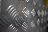 Aluminium/metallic checker plate safety slip floor. Backgrount texture pattern