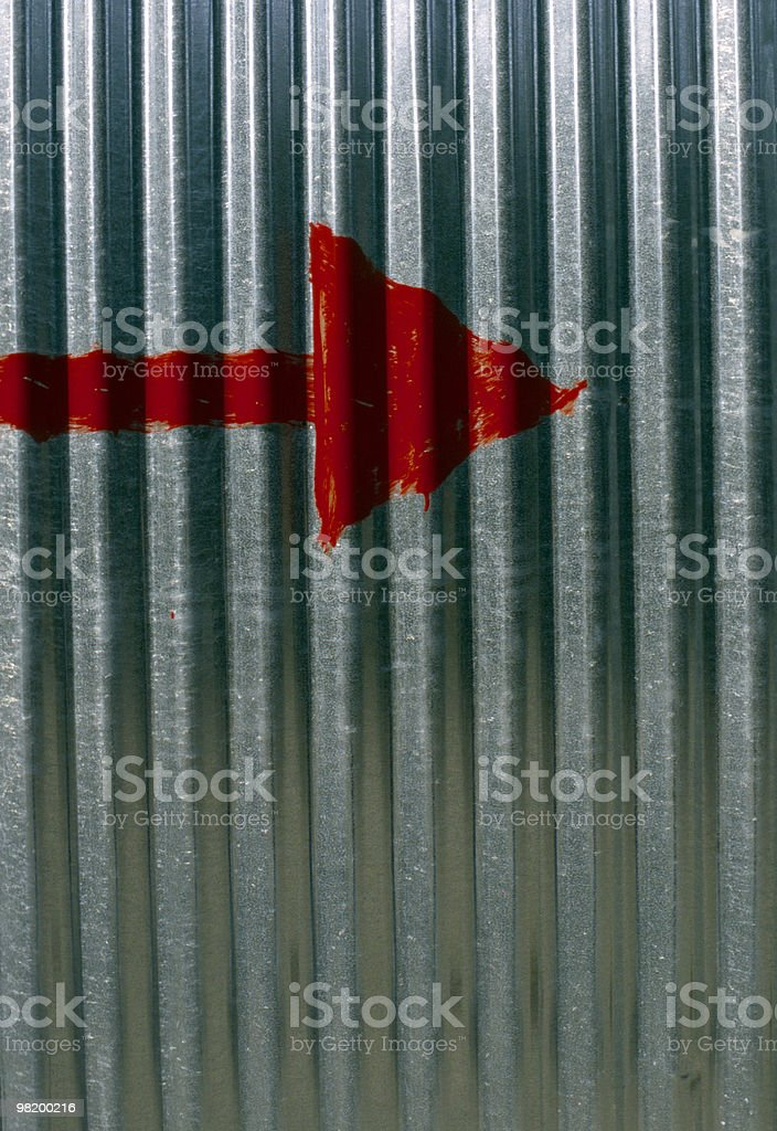 Aluminum / Arrow Painted Upon Undulated Metal / Red Sign Tin Symbol royalty-free stock photo