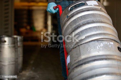 Aluminum barrels pushed on hand truck