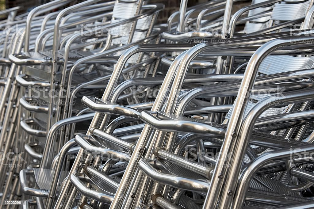 Aluminum chairs stacked royalty-free stock photo