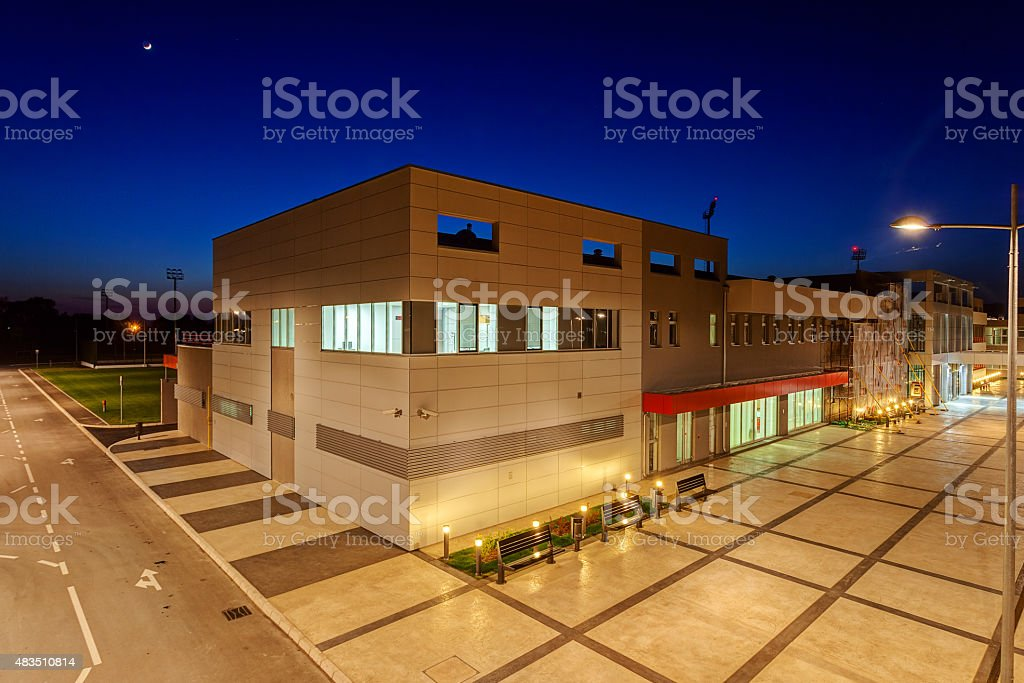 Aluminum facade on residential building at night stock photo