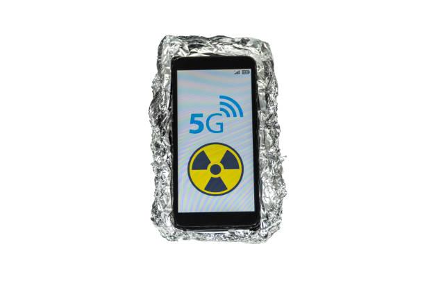 Aluminum foil smart phone case and 5g danger sign stock photo