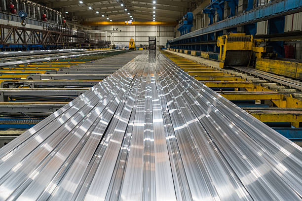 aluminum lines on a conveyor belt in a factory - aluminium bildbanksfoton och bilder