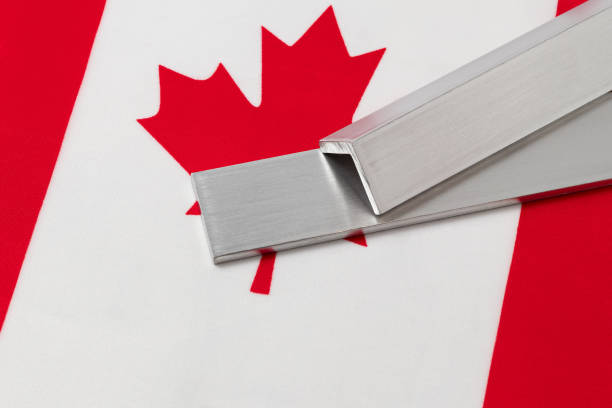 Aluminum metal stock on flag of Canada. Concept of trade war, tariffs, fair trade and steel industry. stock photo