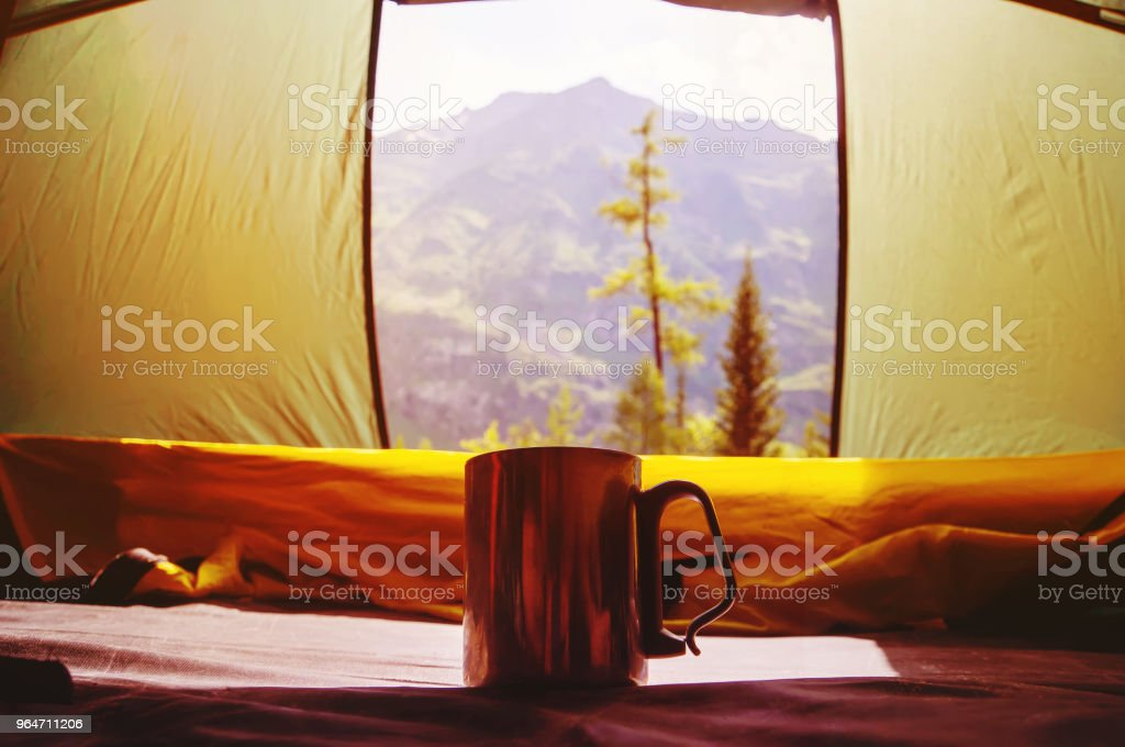 Aluminum mug with hot chaet is in the tent royalty-free stock photo