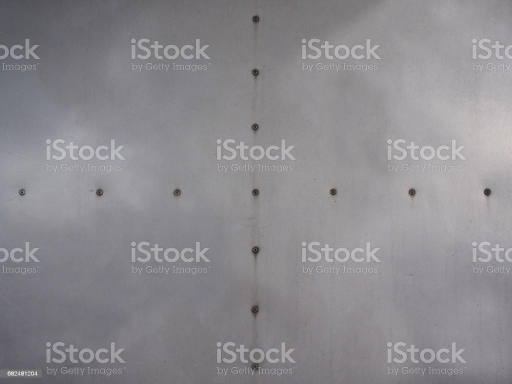 aluminum plate wall with rivets stock photo