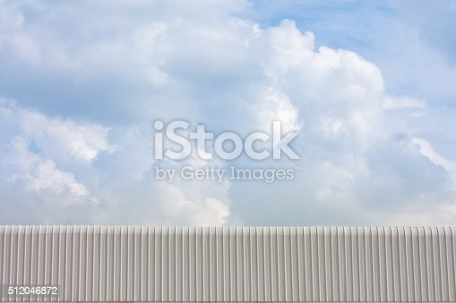 istock aluminum roof over blue sky 512046872