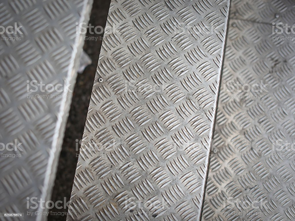 Aluminum steps on a stairway with non-slip pattern. stock photo