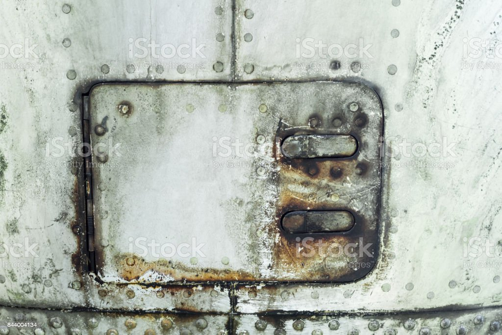 Aluminum surface of the aircraft fuselage stock photo