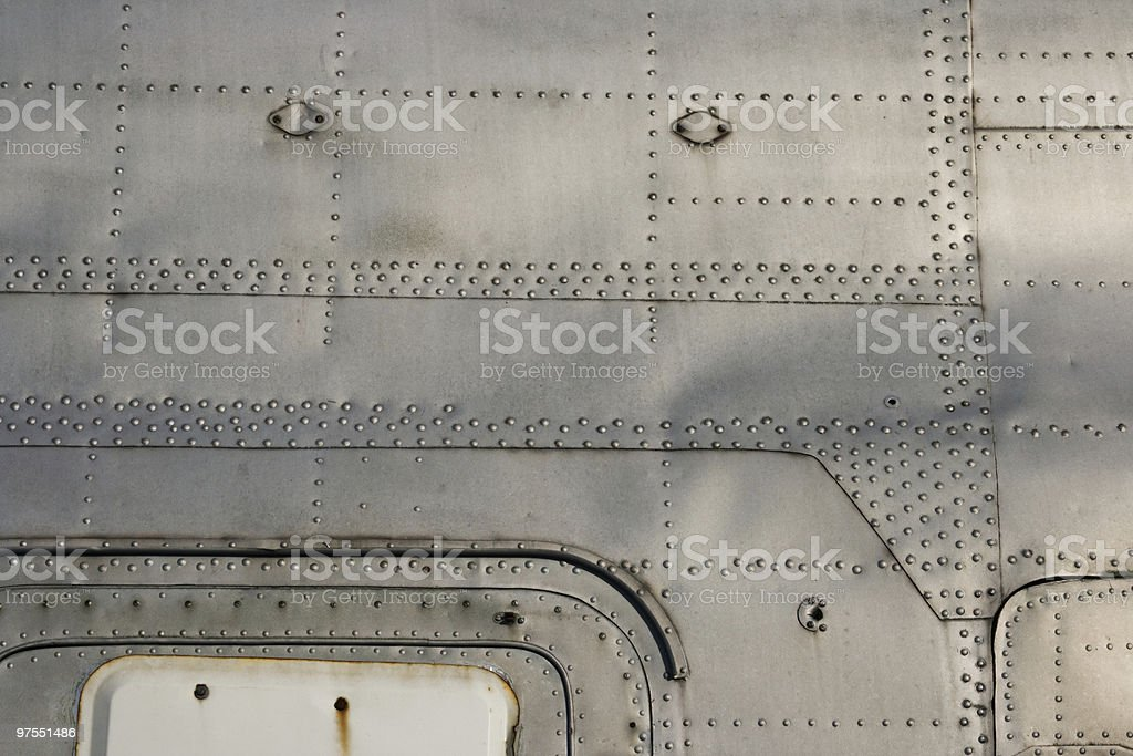 Aluminum trailer close-up showing grime and rusted studs royalty-free stock photo