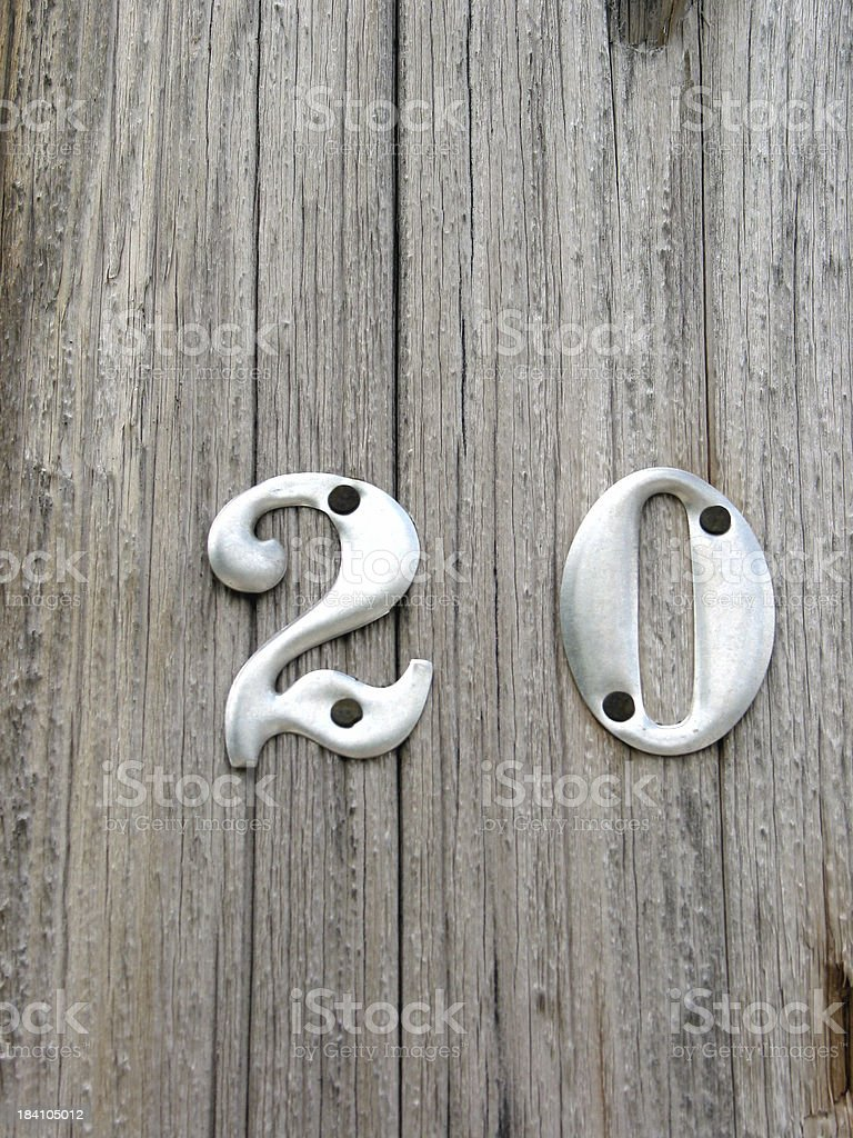 Aluminum Twenty Numerals on a wooden pole royalty-free stock photo