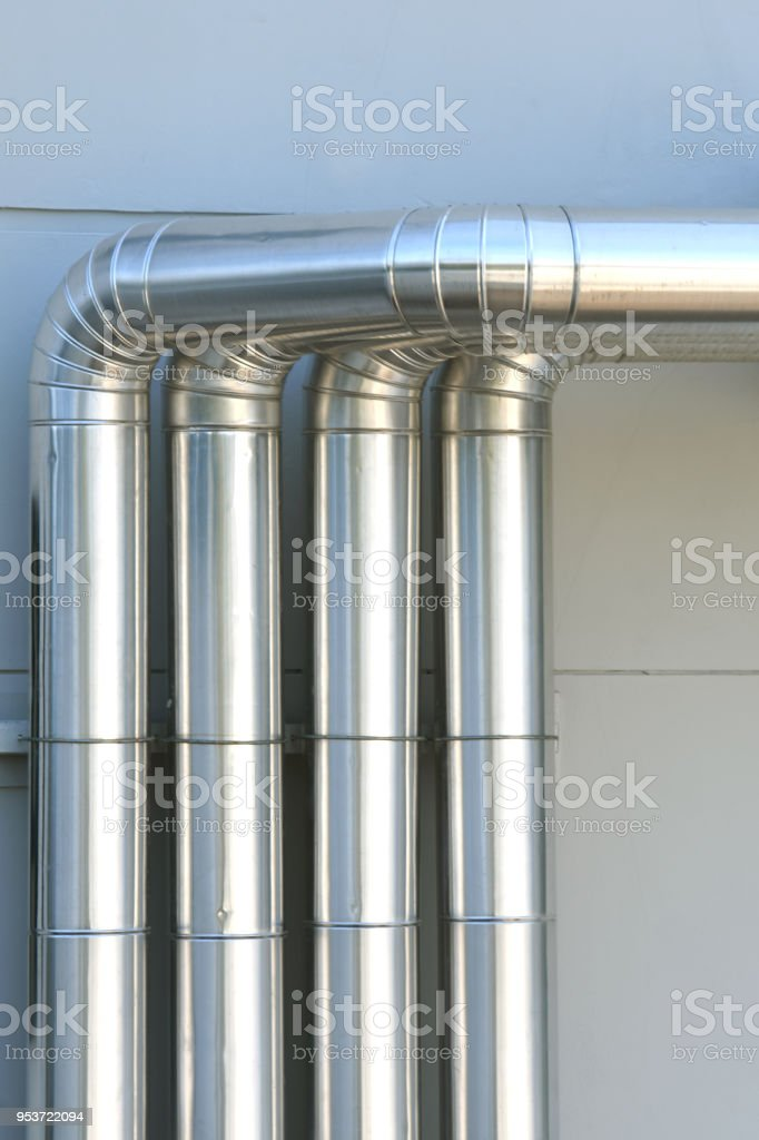 Aluminum ventilation air Pipes in building. stock photo