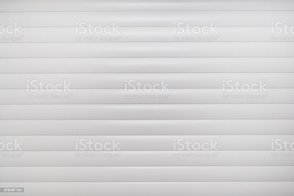 Aluminum white industrial roller shutters background. stock photo