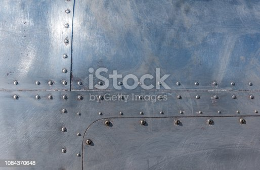 104243412 istock photo Aluminum with rivets 1084370648