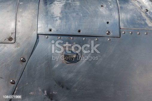 104243412 istock photo Aluminum with rivets 1084371966