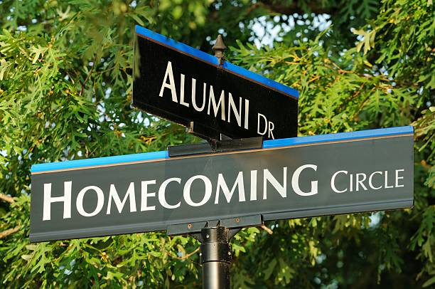 Alumni and homecoming street signs close up  alumnus stock pictures, royalty-free photos & images