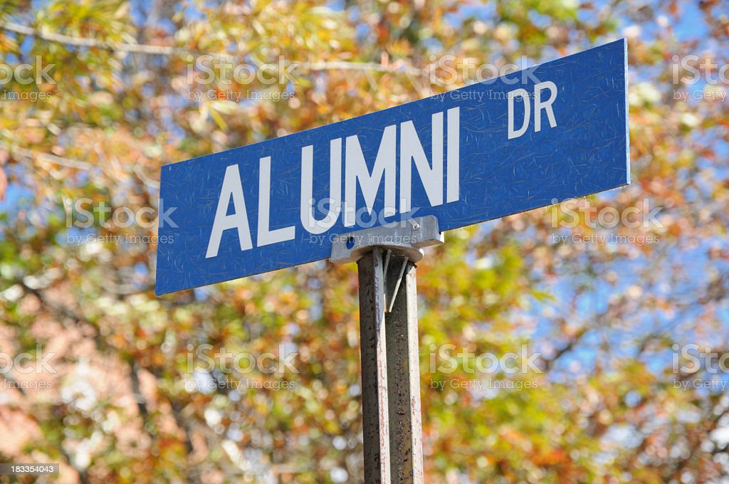 Alumni drive street sign close up stock photo