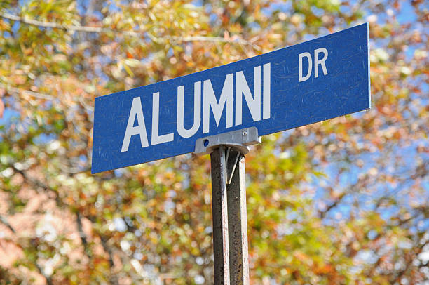 Alumni drive street sign close up Alumni drive sign at university alumnus stock pictures, royalty-free photos & images