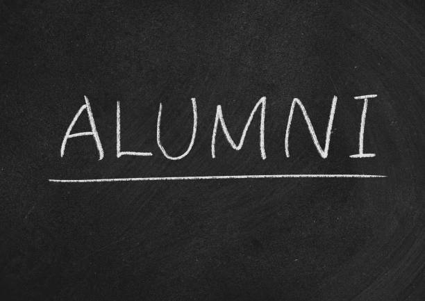 alumni alumni concept word on a blackboard background alumnus stock pictures, royalty-free photos & images