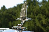 Apeldoorn, The Netherlands - September 4, 2005: Metal Eagle hood ornament on a classic Alvis car. Alvis Car and Engineering Company Ltd was a British manufacturing company in Coventry, England. From 1919 untli 1967