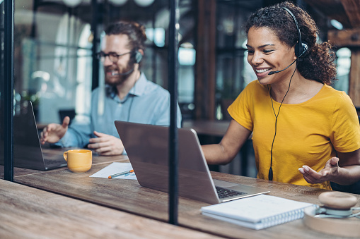 Call center professionals working side by side in the office