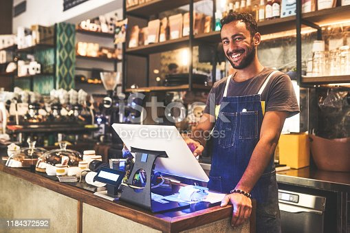 Portrait of a young man working in a cafe