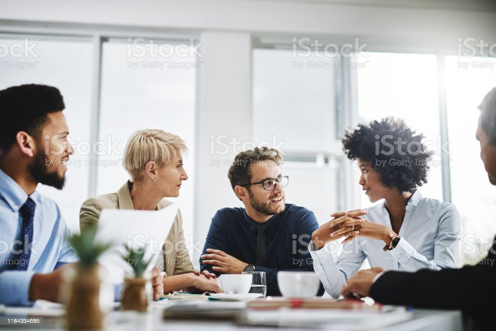 Always brainstorming Cropped shot of a diverse group of businesspeople sitting together and having a meeting in the office 20-29 Years Stock Photo