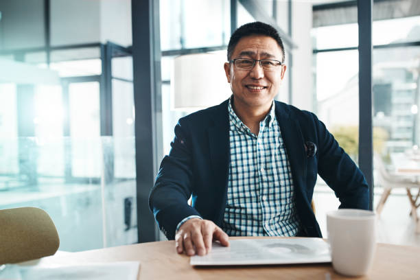 I always bring success to my name Portrait of a mature businessman working in an office japanese ethnicity stock pictures, royalty-free photos & images