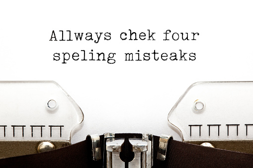 Text with errors Always Check For Spelling Mistakes typed on vintage typewriter with copy space.