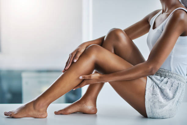 Always finish up with a moisturizer! Cropped shot of a young woman caressing her legs rubbing stock pictures, royalty-free photos & images