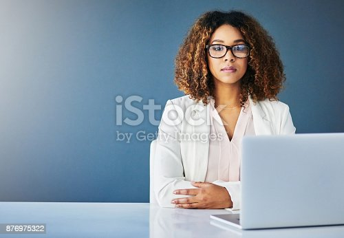 istock Always focused at work 876975322