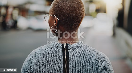 Rearview shot of a young businesswoman walking outdoors in the city