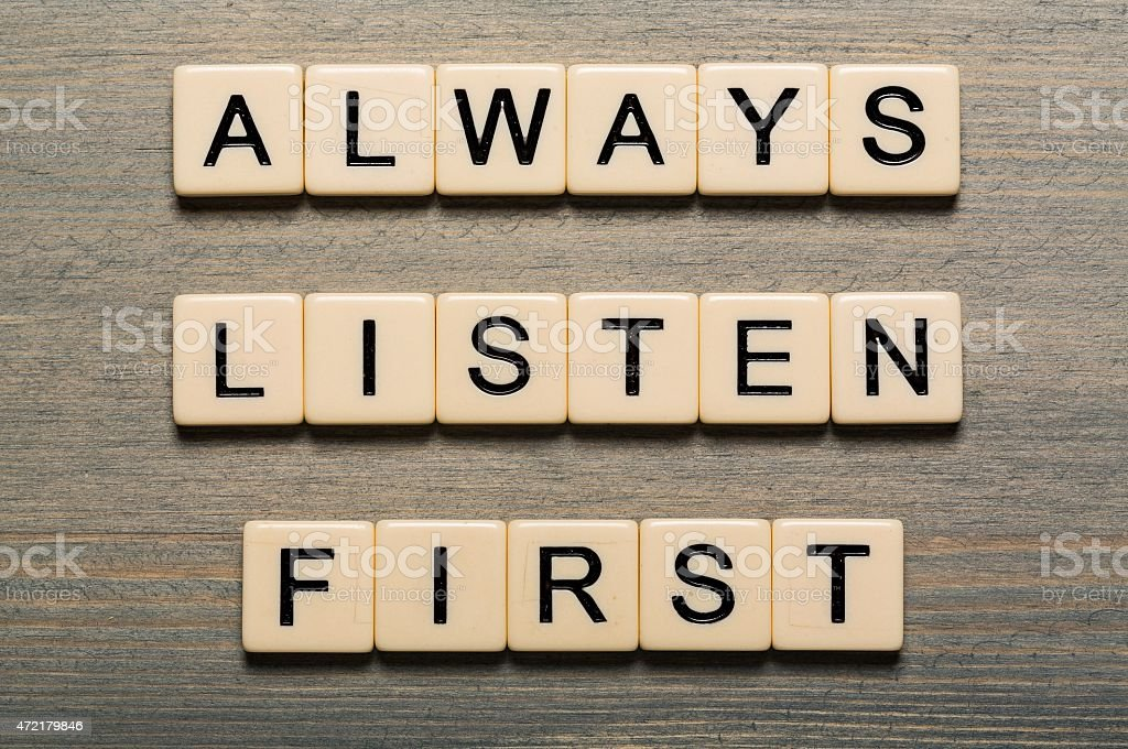 Always Listen First card with colorful background with defocused lights stock photo
