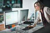Shot of a businesswoman editing a sheet on her computer