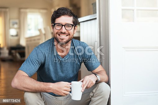 Cropped portrait of a handsome young man enjoying a cup of coffee in the morning
