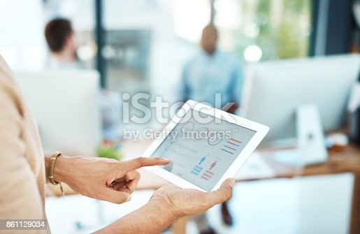 Cropped shot of a businesswoman using her digital tablet in the office