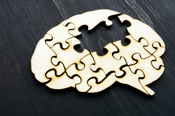 Alzheimers disease concept. Brain from wooden puzzles without one. stock photo