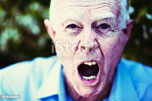 661896674istockphoto Alzheimers or simply angry? Very grumpy old man shouting. 628304694
