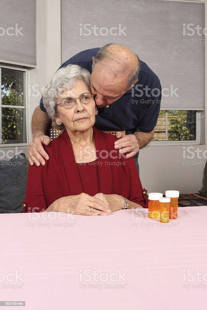 Alzheimer's Woman Comforted by Husband Vertical royalty-free stock photo