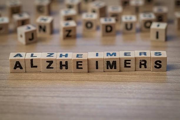 Alzheimers written in wooden cubes stock photo
