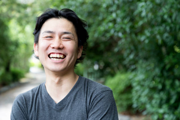 I am always happy! Portrait of a young and cheerful japanese man. japanese ethnicity stock pictures, royalty-free photos & images