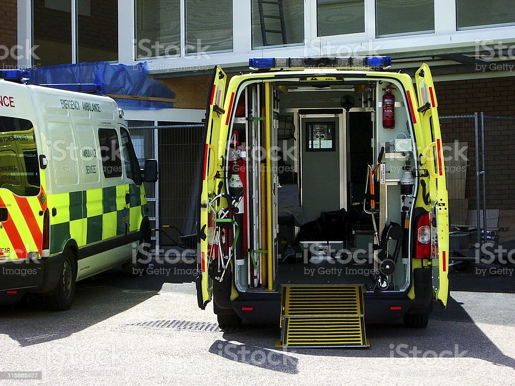 Am ambulance with its back doors open at a uk hospital stock photo