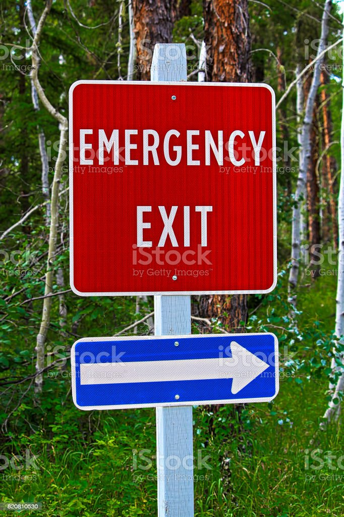 Am angled view of an emergency exit sign.