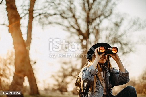 Young woman explorer walking in forest