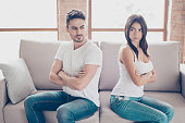 istock I am not talking to you! Mistrust and cheat problems. Annoyed couple is ignoring each other, sitting on the couch back to back indoors at home 940004838