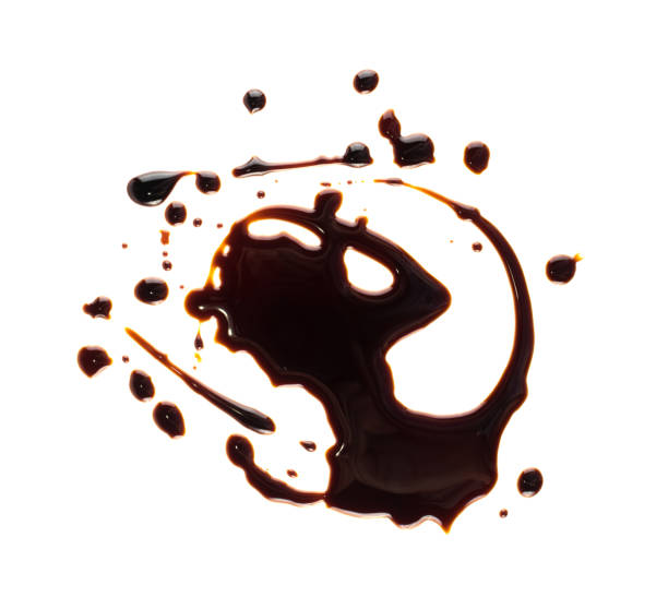 Soy Souse Teriyaki Spilled Soy Souse Teriyaki Texture. Oyster Sauce or Balsamic Vinegar Puddles on White Background Top View balsamic vinegar stock pictures, royalty-free photos & images