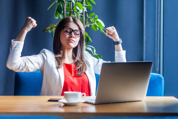 i am strong and independent. portrait of proud beautiful stylish brunette young woman in glasses sitting, looking at her laptop screen on video call. - side hustle stock pictures, royalty-free photos & images